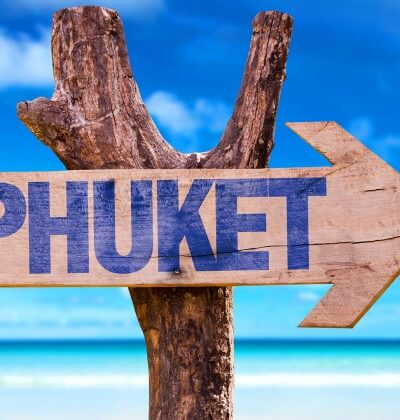 Phuket sign post with ocean backdrop
