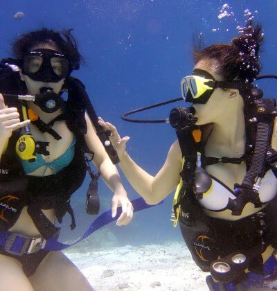 Two Female Open Water students In Phuket Thailand, with Aussie Divers
